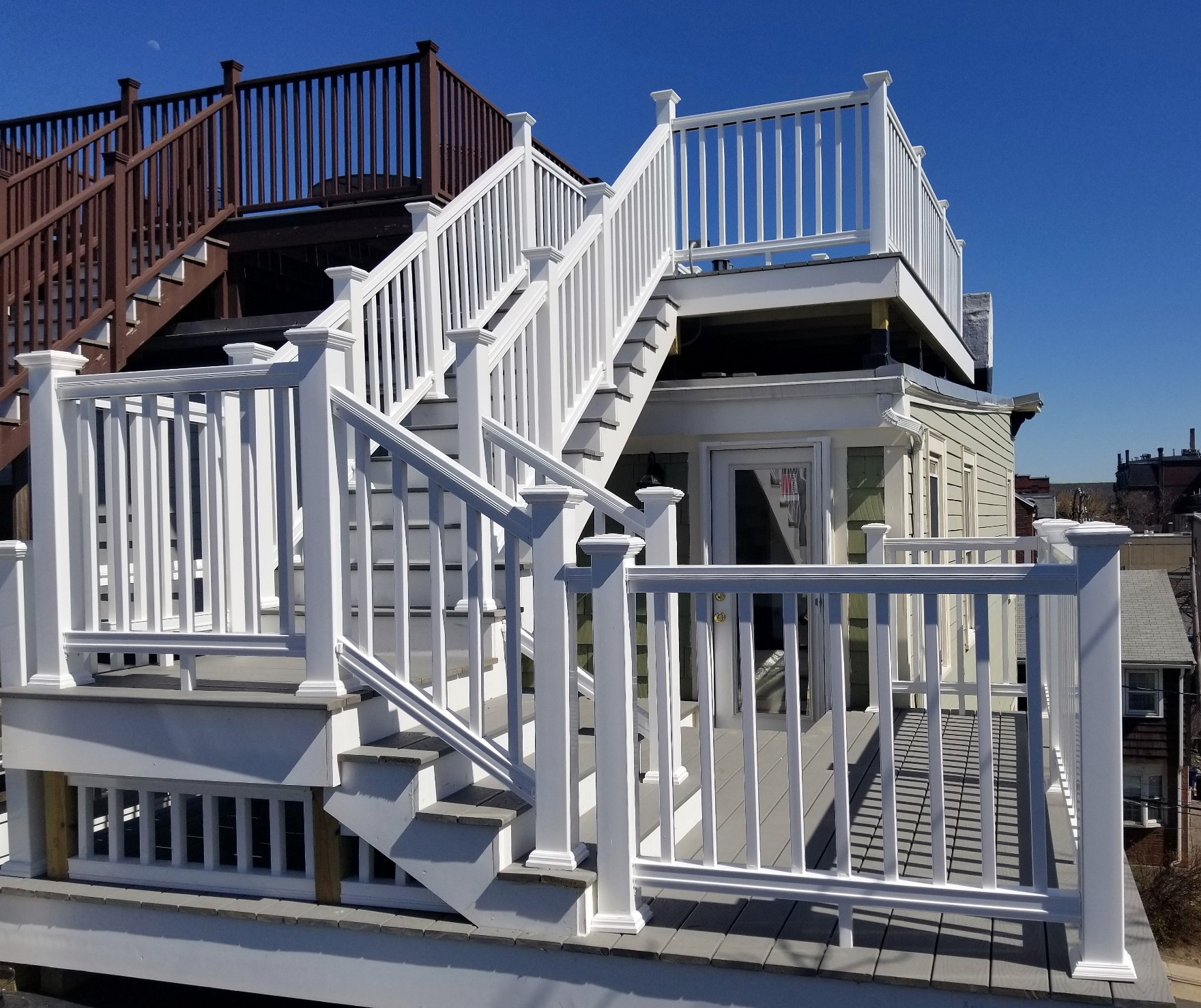 multilevel deck with trax and pvc handrails