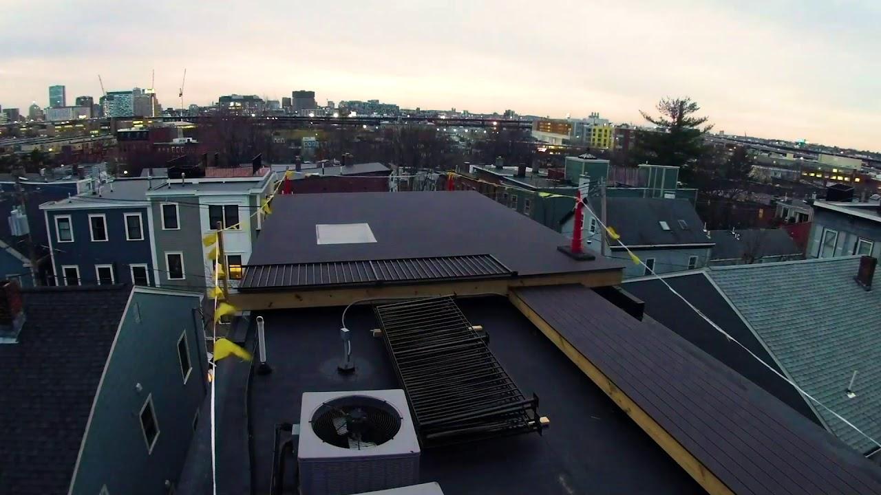 roof deck, gopro, timelapse, charlestown, boston, trex select, composite decking, black metal spiral staircase, custom handrails, walkable glass skylight