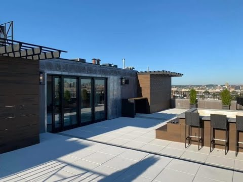 south boston construction of penthouse full gut remodel with roof deck and front deck