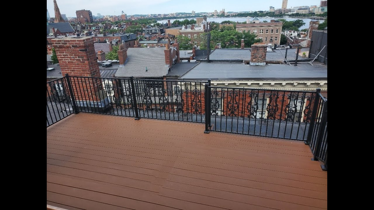 boston ROOF DECK WITH COMPOSITE DECKING AND BLACK METAL HANDRAILS